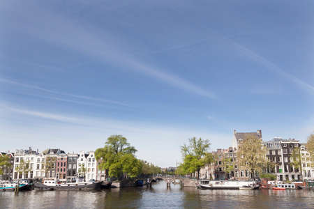 amstel: Amstel and herengracht on a sunny spring morning in amsterdam