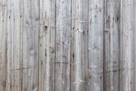 wood fences: Part of fence with grey weathered vertical planks Stock Photo