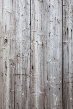 Vertical part of fence with grey weathered planks Stock Photo
