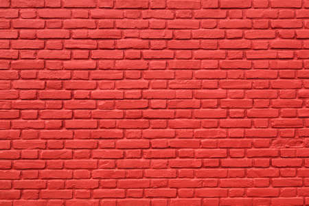 Horizontal part of red painted brick wall