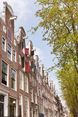 canal houses: Facades of canal houses on leidsegracht in centre of amsterdam with green trees in spring