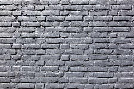 Horizontal part of grey painted brick wall Stock Photo