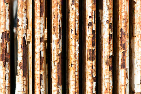 Old central heating radiator with cracked white paint and rust Stock Photo