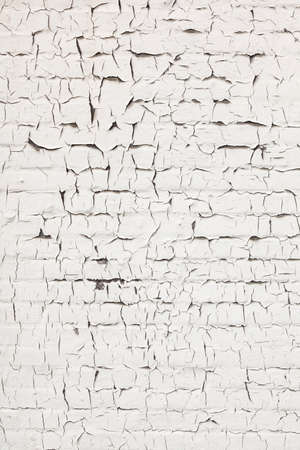 white washed: abstract pattern of cracks in old and grungy white washed brick wall