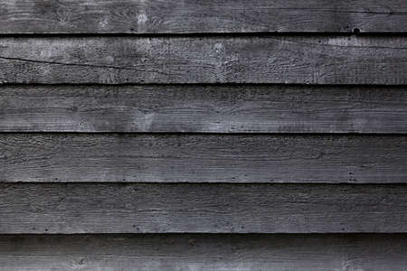 part of black wooden fence or part of black painted barn Stock Photo