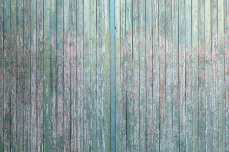 large doors: large old barn doors with peeling green paint