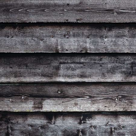 old barn: square part of old black and grey wooden barn wall Stock Photo