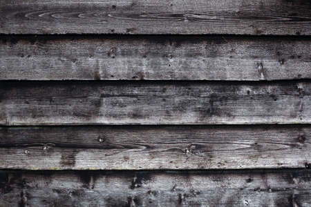 old barn: grungy background consisting of part of old black and grey wooden barn wall