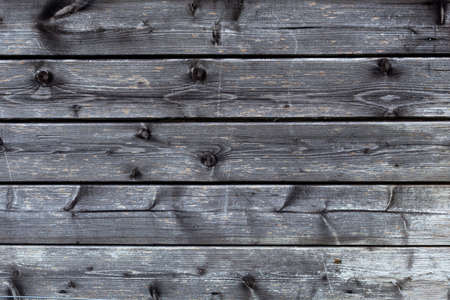 old barn: part of old black and grey wooden barn wall