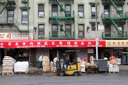 hard working people: hard working people in front of shops on allen street in chinatown manhattan new york city