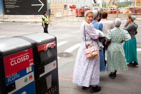 amish: mennonite girls in traditionel dress on the street in new york city near ground zero