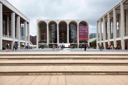 new york city, 12 september 2015: people walk on square in front of metropolitan opera house at lincoln centre in new york city