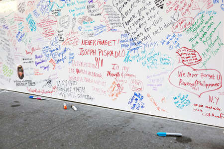9 11: new york city, 11 september 2015: writings on wall near ground zero in new york city for patriot day Editorial