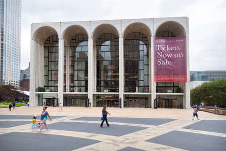 new york city, 12 september 2015: people walk on square in front of metropolitan opera at lincoln centre in new york city Editorial