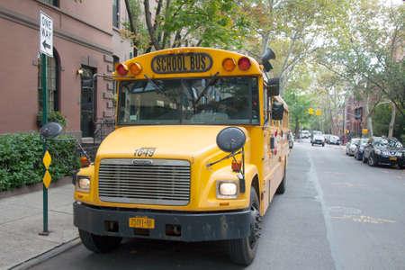 yellow school bus waits on the street in broolyn heights