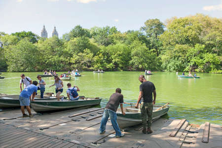 boathouse: New York City, 14 september 2015: people row in boats on new york city central park pond near boathouse