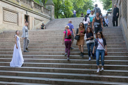 bethesda: New York City, 14 september 2015: wedding couple and many people on steps of bethesda Arcade in new york city central park Editorial