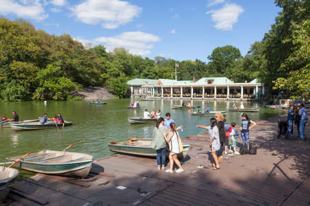 city park boat house: New York City, 14 september 2015: people row in boats on new york city central park pond near boathouse