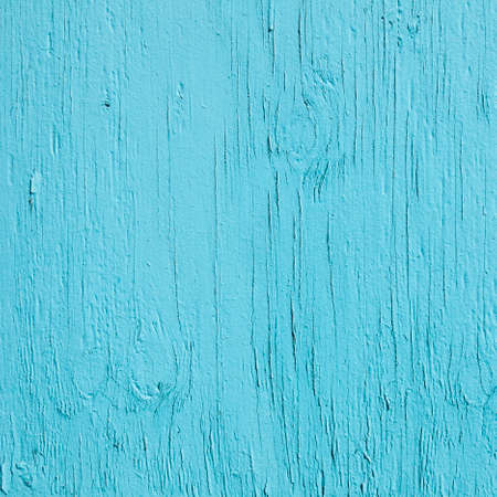 greenish blue: square part of old  wood with fading cracked turqoise paint