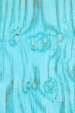 fading: vertical part of old cracked wood with fading turqoise paint Stock Photo