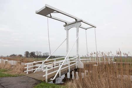 drawbridge: old white drawbridge in the netherlands near Amsterdam