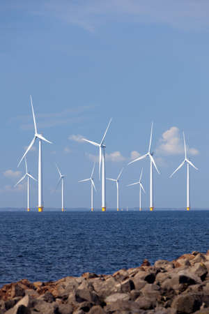 flevoland: wind turbines in water of ijsselmeer off the coast of flevoland with blue sky in the netherlands