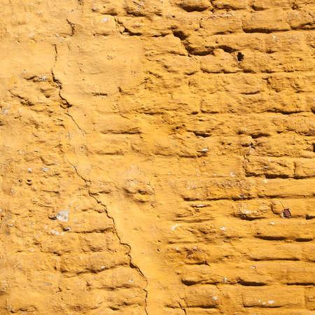 ochre: square part of ochre yellow painted brick wall Stock Photo