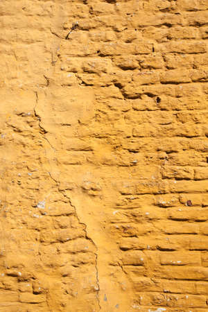 yellow  ochre: vertical part of ochre yellow painted brick wall Stock Photo
