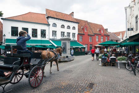 belgian horse: horse carriage in old part of belgian city brugge near begijnhof Editorial