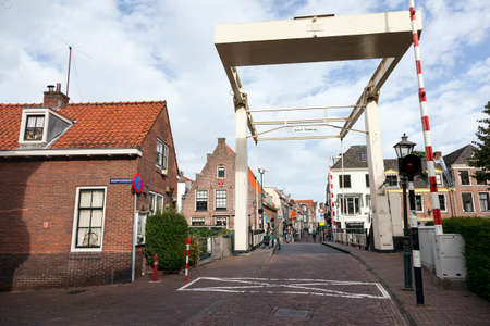 old wooden drawbridge and old houses in centre of Maarssen