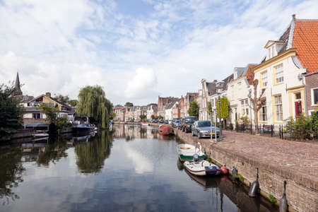 boats, cars and houses along river Vecht in the dutch village of Maarssen in the netherlands Editöryel