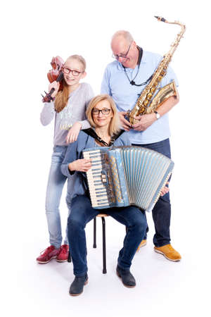 musical family with saxophone, violin and accordion in studio against white background