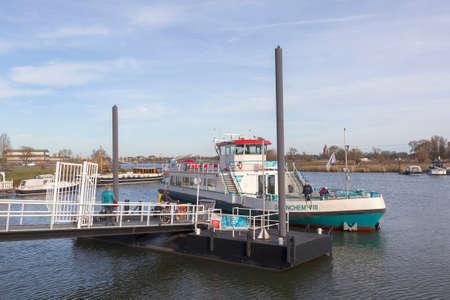 passengers board ferry to gorinchem at port of sleeuwijk in dutch town of sleeuwijk