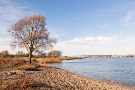 river merwede near sleeuwijk and gorinchem and bridge over highway A27 in holland Stock Photo