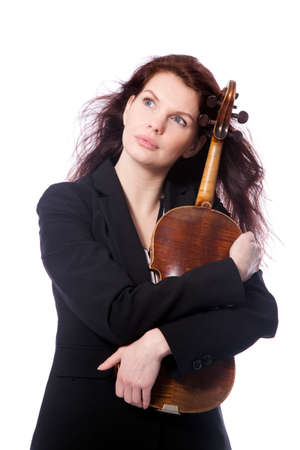 symphonic: classical brunette beauty in suit holds violin in studio against white background