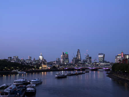 skyscrapers in london city with st pauls cathedral at night behind blackfriars bridge over thames river Stock Photo