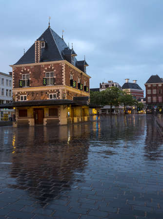 building Waag at dusk in the center of old city leeuwarden - cultural capital of Europe in 2018 - in friesland which is a province of the netherlands Stock Photo