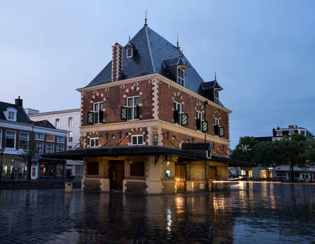 building Waag at dusk in the center of old city leeuwarden - cultural capital of Europe in 2018 - in friesland which is a province of the netherlands 写真素材