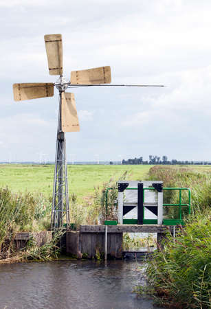 small windmill for pumping water in dutch eempolder near Huizen and Amersfoort in the netherlands