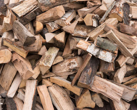 horizontal picture of firewood ready to burn in closeup