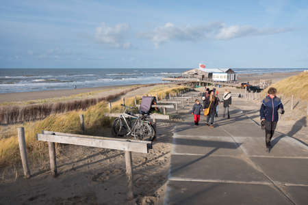 camperduin, Netherlands, 17 december 2017: people leave north sea beach of camperduin in holland Editorial