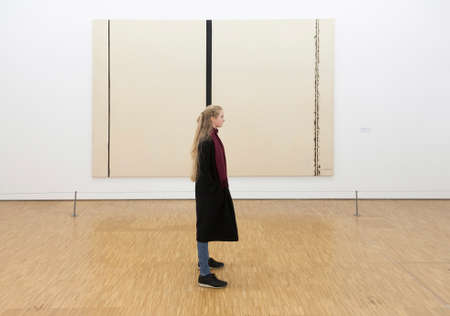 girl in front of painting by barnett newman in museum centre pompidou in paris