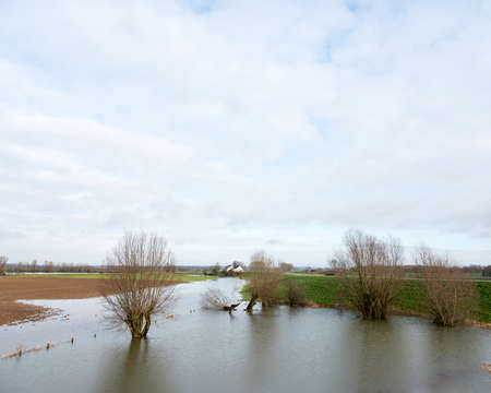 flooded floodplains of river lek in dutch area Betuwe in the netherlands Stock Photo