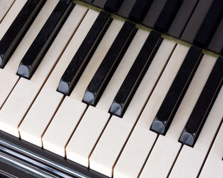 closeup of black and white keys on old ivory keyboard of antique bechstein grand piano Stock Photo
