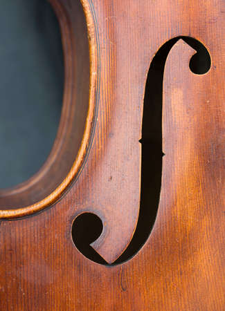 closeup of old double bass with f hole in resonance box Banque d'images - 95748475
