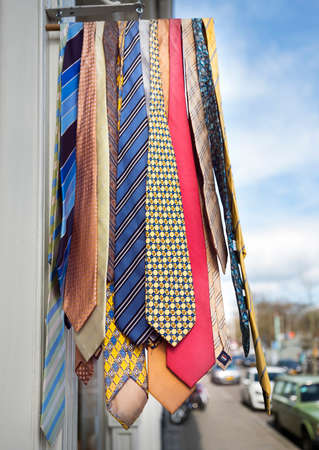 colorful ties hang from rack outside shop in the dutch city of utrecht Stock Photo
