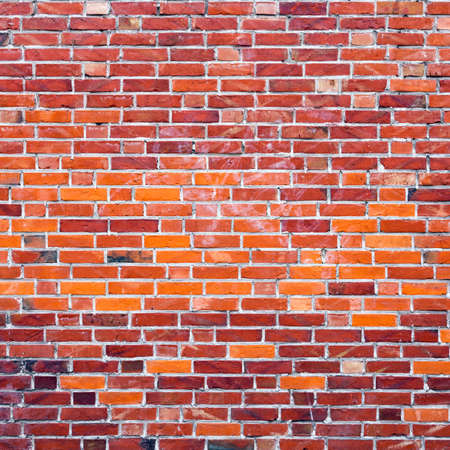 part of wall masonry with bright red old bricks Stock Photo