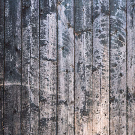 background consisting of old brown grey grungy part of wooden barn door