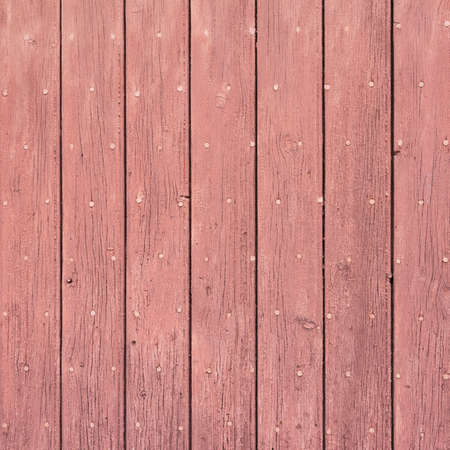 background consisting of reddish brown peeling paint on wooden shutters 写真素材
