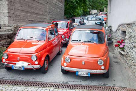 Introd, Italy, 28 july 2018: old fiat 500 cars of members of fiat club in narrow italian street